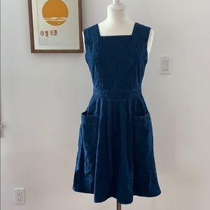Sleeveless denim dress low cut sides with pockets